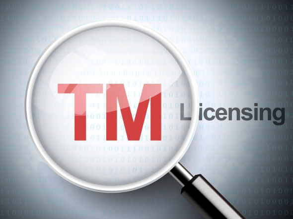 magnifying glass with trademark icon