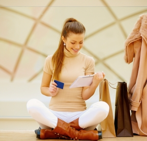 Beautiful woman making online shopping using digital tablet